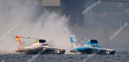 Jimmy Shane, Andrew Tate Jimmy Shane, right, driving the HomeStreet Bank boat, races against Andrew Tate, left, driving the Les Schwab Tires boat, in the H1 Unlimited Albert Lee Appliance Cup final during Seafair weekend, in Seattle. Tate crossed the finish line first, but was given a penalty resulting in a victory for Shane