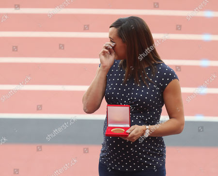 Jessica Ennis of Great Britain is awarded her Heptathlon Gold Medal from the 2011 World Championships
