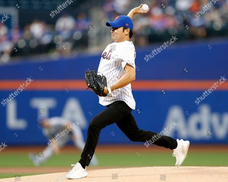 South Korean actor Jang Dong Gun throws out the ceremonial first pitch before a baseball game between the New York Mets and the Los Angeles Dodgers, in New York