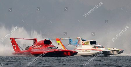 J. Michael Kelly, left, driving the Graham Trucking boat, races against Andrew Tate, right, driving the Les Schwab Tires boat, in the H1 Unlimited Albert Lee Appliance Cup final during Seafair weekend, in Seattle. Tate crossed the finish line first, but was given a penalty that knocked him out of contention. Kelly finished second