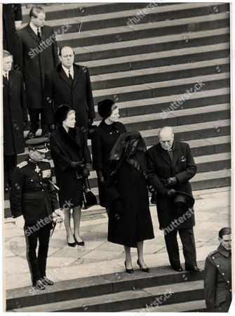 Editorial picture of The Funeral Of Former Prime Minister Sir Winston Churchill In 1965. Picture Shows Clementine Churchill (1885 - 1977) Lady Churchill Baroness Spencer-churchill Of Chartwell (created 1966) Leans On The Arm Of Her Son Randolph Churchill (19111968) On Th