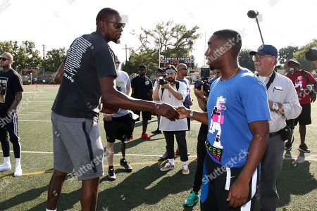 Kevin Durant, Demetrius Shipp Jr Kevin Durant, left, and Demetrius Shipp Jr. attend the 4th Annual Athletes vs Cancer Celebrity Flag Football Game held at John Burroughs High School, in Burbank, Calif