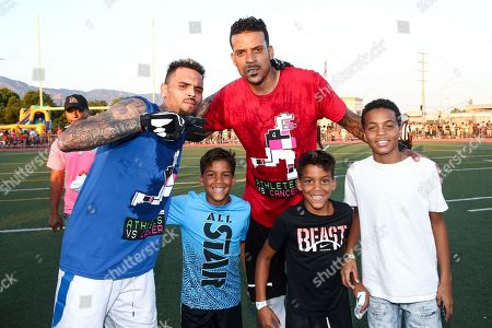 Chris Brown, Matt Barnes, Carter Kelly Barnes, Isaiah Michael Barnes Chris Brown, from left to right, Matt Barnes, Carter Kelly Barnes and Isaiah Michael Barnes attend the 4th Annual Athletes vs Cancer Celebrity Flag Football Game held at John Burroughs High School, in Burbank, Calif