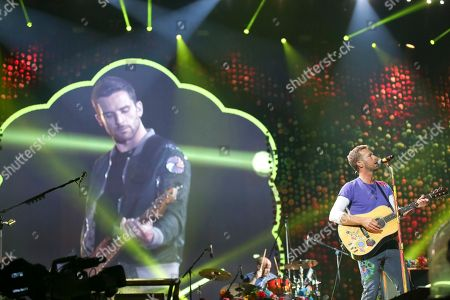 Guy Berryman, Chris Martin Bassist Guy Berryman, left, and singer Chris Martin, of Coldplay, perform at the FedEx Field, in Landover, Md