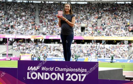 Britain's Jessica Ennis receives a gold medal during the medal reallocation ceremony for the women's Heptathlon event from the 2011 IAAF World Championships in Daegu at the London Stadium during the IAAF World Championships in London