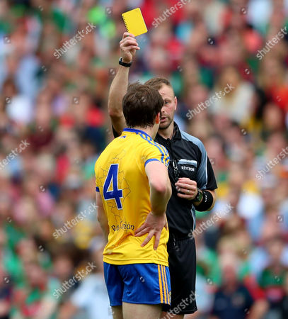 Roscommon vs Mayo. Roscommon's David Murray yellow carded by referee Anthony Nolan