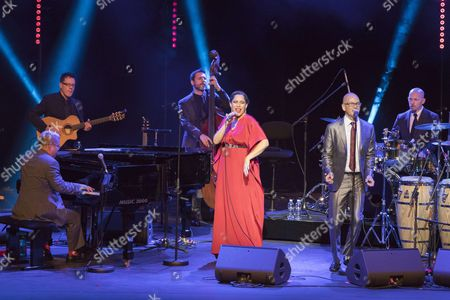 Pink Martini featuring China Forbes (C), pianist Thomas M. Lauderdale (L) perform during the 'Sporting Summer Festival' at Opera Garnier in Monte-Carlo