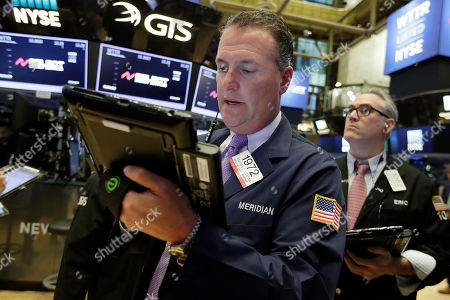 Jonathan Corpina, Eric Schumacher Traders Jonathan Corpina, left, and Eric Schumacher work on the floor of the New York Stock Exchange, . Stocks are little changed in early trading as technology companies rise and energy companies slip with the price of oil