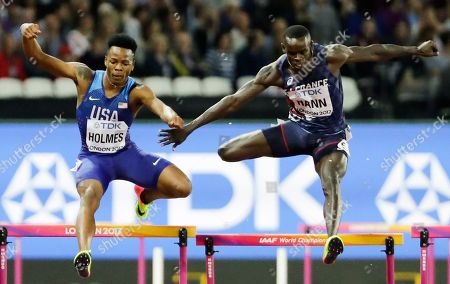 United States' Tj Holmes, left, and France's Mamadou Kasse Hann clear the last during a Men's 400m hurdles semifinal during the World Athletics Championships in London
