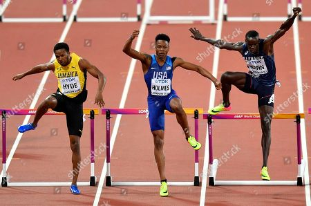 United States' Tj Holmes, centre, leads Jamaica's Jaheel Hyde, left, and France's Mamadou Kasse Hann during their Men's 400 meters hurdles semifinal at the World Athletics Championships in London