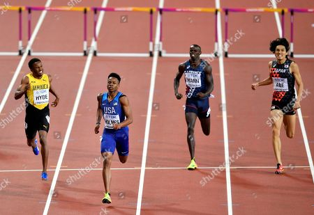 United States' Tj Holmes, second left, leads Jamaica's Jaheel Hyde, left, France's Mamadou Kasse Hann and Japan's Takatoshi Abe during their Men's 400 meters hurdles semifinal at the World Athletics Championships in London