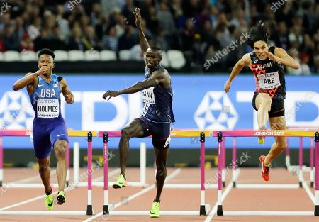 United States' Tj Holmes, left, France's Mamadou Kasse Hann and Japan's Takatoshi Abe at the last during a Men's 400m hurdles semifinal during the World Athletics Championships in London