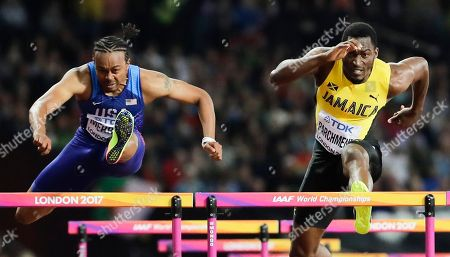 United States' Aries Merritt, left, and Jamaica's Hansle Parchment compete in the final of the Men's 110m hurdles during the World Athletics Championships in London