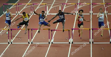 Tj Holmes of USA (centre) during the Men's 400 metres hurdles heats