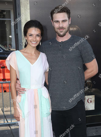 Stock Photo of Grey Damon and Alice Greczyn