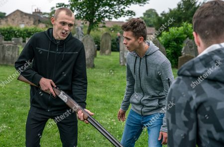 Stock Photo of Ep 7903 Wednesday 9th August 2017 A wound-up Josh, as played by Conner Chapman, stupidly takes Pollard's shotgun and after some teasing from Jamie and his gang, before long the gun has been fired and the police called. Also pictured Jacob Gallagher, as played by Joe Warren Plant,