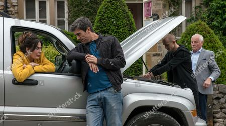 Stock Image of Ep 7900 Monday 7 August 2017 -  Pollard, as played by Chris Chittell, is taking Faith Dingle, as played by Sally Dexter, out to dinner but can't get his car started. Cain Dingle, as played by Jeff Hordley, is unhappy about Pollard taking his mum out and is reticent to help. Soon Josh, as played by Conner Chapman, turns up and fixes the car leaving Pollard begrudgingly impressed.