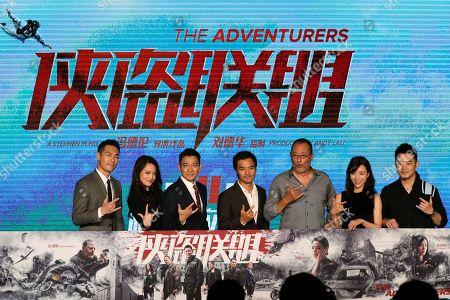 "Andy Lau, Shu Qi, Stephen Fung, Jean Reno, Zhang Jingchu Celebrities from left; Taiwanese actor Tony Yo-ning Yang, Taiwanese actress Shu Qi, Hong Kong actor Andy Lau, Hong Kong actor-director Stephen Fung, French actor Jean Reno, Chinese actress Zhang Jingchu gestures as they pose with a poster of their latest movie ""The Adventurers"" on stage during a news conference at a hotel in Beijing, . The movie will start to be shown at cinemas worldwide on Aug. 11"