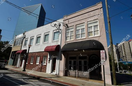 Stock Picture of This, photo shows a two-story brick building, right, at the northwest edge of Atlanta's old downtown. The old building is where the first country music hit was recorded in 1923 by Fiddlin' John Carson. It faces the threat of demolition to make way for a Jimmy Buffett's Margaritaville restaurant