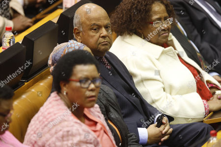 Former finance minister Pravin Gordhan (C) seen in Parliament prior to a motion of no confidence vote against South African President Jacob Zuma in a sitting of parliament in Cape Town, South Africa 08 August 2017. Rallies and protests across the country planned by opposition parties have been organized to mark the vote of no confidence against Zuma as the embattled ANC leader faces pressure from the public and opposition parties to stand down. He has been accused of corruption and state capture.