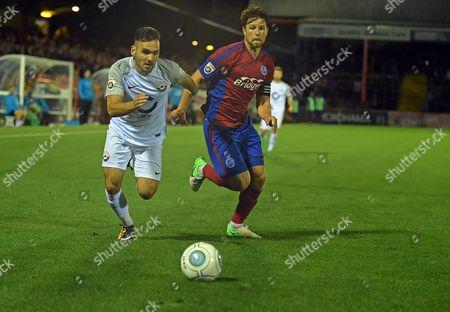 Jake Gosling (11) of Torquay United under pressure from Callum Reynolds (22) of Aldershot Town