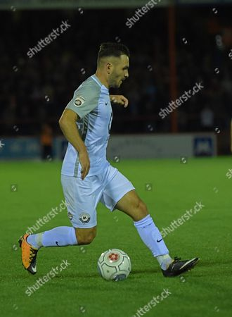 Jake Gosling (11) of Torquay United does step over
