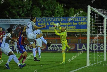 Stock Picture of Jake Cole (1) of Aldershot Town saves under pressure from Rory Fallon (16) of Torquay United