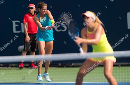 Julia Goerges of Germany & Olga Savchuk of the Ukraine playing doubles at the 2017 Rogers Cup WTA Premier 5 tennis tournament