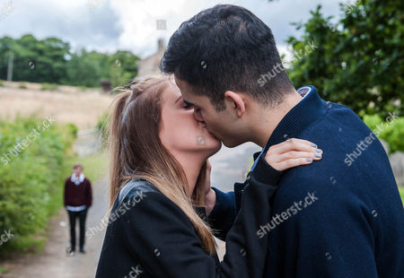 Ep 7297 Tuesday 22 September 2015 Belle Dingle, as played by Eden Taylor-Draper, is mortified to hear from Kirin Kotecha, as played by Adam Fielding, that her parents have giving him a warning. She hints she wants Kirin to kiss her and they end up snogging unaware Lachlan White, as played by Thomas Atkinson, jealously watches on.