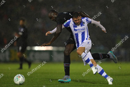 Drey Wright of Colchester United and Christopher Samba of Aston Villa fight for the ball - Colchester United v Aston Villa, Carabao Cup first round, Weston Homes Community Stadium, Colchester - 9th August 2017.