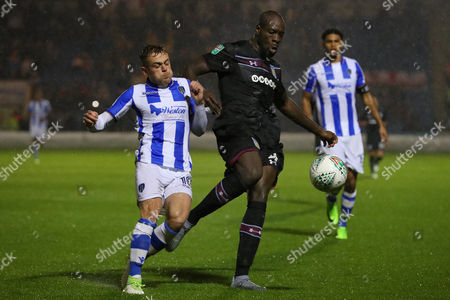 Sammie Szmodics of Colchester United and Christopher Samba of Aston Villa - Colchester United v Aston Villa, Carabao Cup first round, Weston Homes Community Stadium, Colchester - 9th August 2017.