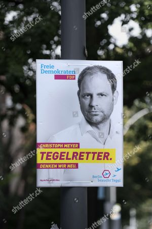 Campaign poster of the party FDP with photo of Christopher Meyer mit Slogan Tegelretter, Freie Demokratische Partei, with Slogan Digital First Bedenken second for their election campaign in front of the CDU headquarter Konrad-Adenauer-Haus in Berlin, Germany