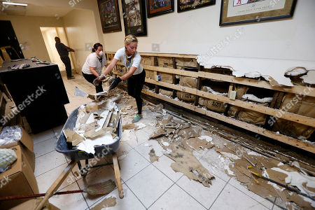 Pre-med studentsDanielle Ziemba, right, and Lorena Garcia, from the Miami Medical Team, help gut the Zulu Social Aid & Pleasure Club Store, which flooded during rain storms this past weekend, in New Orleans