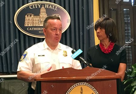 Baltimore Mayor Catherine Pugh and Police Commissioner Kevin Davis discuss updates to the city's violence prevention plan at a news conference on in Baltimore. Pugh appointed Drew Vetter, chief of staff for the Baltimore Police Department, to be the director of the Mayor's Office of Criminal Justice