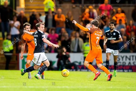 Stock Photo of Dundee forward Paul McGowan (#18) and Dundee United forward Paul McMullan (#7) contest the ball in the middle of the pitch during the Betfred Scottish Cup match between Dundee and Dundee United at Dens Park, Dundee