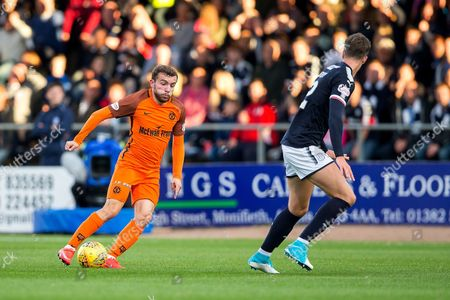Stock Picture of Dundee United forward Paul McMullan (#7) looks to take on Dundee defender Jack Hendry (#22) during the Betfred Scottish Cup match between Dundee and Dundee United at Dens Park, Dundee