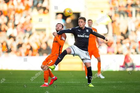 Stock Image of Dundee midfielder Scott Allan (#10) controls the long pass to win the ball ahead of Dundee United forward Paul McMullan (#7) during the Betfred Scottish Cup match between Dundee and Dundee United at Dens Park, Dundee