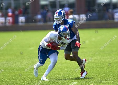 Stock Picture of East Rutherford, New Jersey, U.S. - New York Giants' wide receiver Travis Rudolph (19) and cornerback Valentino Blake (47) go through punting drills at the Quest Diagnostics Training Center in East Rutherford, New Jersey