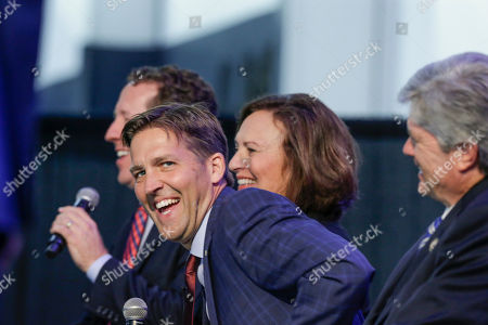 Deb Fisher, Adrian Smith, Ben Sasse, Jeff Fortenberry Senator Ben Sasse, R-Neb, laughs as Rep. Adrian Smith, R-Neb., left, speaks wigh Senator Deb Fisher, R-Neb., second left, center, and Rep. Jeff Fortenberry, R-Neb., right, listen, during a legislative summit featuring Nebraska's elected Congressional and House officials, in Ashland, Neb., . The annual event, held at the Strategic Air Command & Aerospace Museum, is sponsored by the Lincoln, Neb., Chamber of Commerce