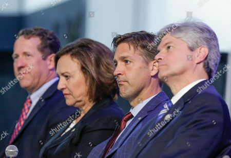 Deb Fisher, Adrian Smith, Ben Sasse, Jeff Fortenberry Rep. Adrian Smith, R-Neb., left, Senator Deb Fisher, R-Neb., second left, Senator Ben Sasse, R-Neb., second right, and Rep. Jeff Fortenberry, R-Neb., right, sit on stage during a legislative summit featuring Nebraska's elected Congressional and House officials, in Ashland, Neb., . The annual event, held at the Strategic Air Command & Aerospace Museum, is sponsored by the Lincoln, Neb., Chamber of Commerce