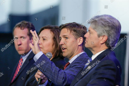 Deb Fisher, Adrian Smith, Ben Sasse, Jeff Fortenberry Rep. Adrian Smith, R-Neb., left, Senator Deb Fisher, R-Neb., second left, and Rep. Jeff Fortenberry, R-Neb., right, listen to Senator Ben Sasse, R-Neb., second right, as they sit on stage during a legislative summit featuring Nebraska's elected Congressional and House officials, in Ashland, Neb., . The annual event, held at the Strategic Air Command & Aerospace Museum, is sponsored by the Lincoln, Neb., Chamber of Commerce