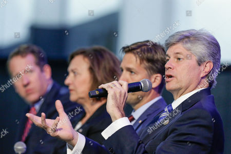 Deb Fisher, Adrian Smith, Ben Sasse, Jeff Fortenberry Rep. Adrian Smith, R-Neb., left, Senator Deb Fisher, R-Neb., second left, and Senator Ben Sasse, R-Neb., second right, listen to Rep. Jeff Fortenberry, R-Neb., right, as they sit on stage during a legislative summit featuring Nebraska's elected Congressional and House officials, in Ashland, Neb., . The annual event, held at the Strategic Air Command & Aerospace Museum, is sponsored by the Lincoln, Neb., Chamber of Commerce