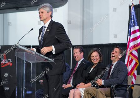 Ben Sasse, Adrian Smith, Deb Fisher, Jeff Fortenberry Rep. Jeff Fortenberry, R-Neb., makes a joke during a legislative summit featuring Nebraska's elected Congressional and House officials, from left: Rep Adrian Smith, R-Neb., Senator Deb Fisher, R-Neb., and Senator Ben Sasse, R-Neb., in Ashland, Neb., . The annual event, held at the Strategic Air Command & Aerospace Museum, is sponsored by the Lincoln, Neb., Chamber of Commerce