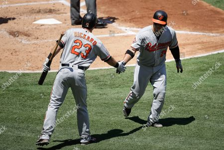 Welington Castillo, Joey Rickard Baltimore Orioles' Welington Castillo, right, is congratulated by Joey Rickard after hitting a home run during the third inning of a baseball game against the Los Angeles Angels, in Anaheim, Calif