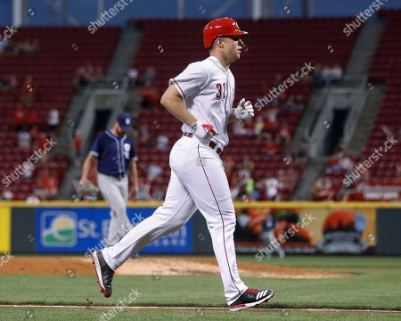 Cincinnati Reds' Stuart Turner runs the bases after hitting a two-run home run off San Diego Padres starting pitcher Travis Wood during the fifth inning of a baseball game, in Cincinnati