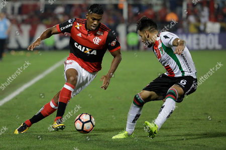 Orlando Berrio of Brazil's Flamengo fights for the ball with Diego Torres of Chile's Palestino during a Copa Sudamericana soccer match in Rio de Janeiro, Brazil