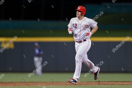 Cincinnati Reds' Stuart Turner runs the bases after hitting a two-run home run off San Diego Padres starting pitcher Travis Wood in the fifth inning of a baseball game, in Cincinnati. The Reds won 8-3