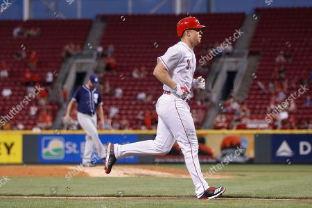 Stuart Turner, Travis Wood Cincinnati Reds' Stuart Turner runs the bases after hitting a two-run home run off San Diego Padres starting pitcher Travis Wood, left, in the fifth inning of a baseball game, in Cincinnati. The Reds won 8-3