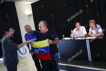 The head of IU International Extension, Francisco Perez (CR) and the exeurodiputado of the PSOE Vicent Garces (R) during the incident with a protestor against President of Venezuela Nicolas Maduro.