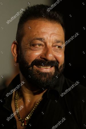 Bollywood actor Sanjay Dutt smiles as he arrives for the trailer launch of film Bhoomi in Mumbai, India, . The film is scheduled to be released on September 22, 2017